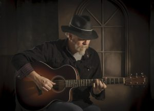 Calgary electric and acoustic blues and roots guitarist, singer and songwriter Neil Hardwire Speers